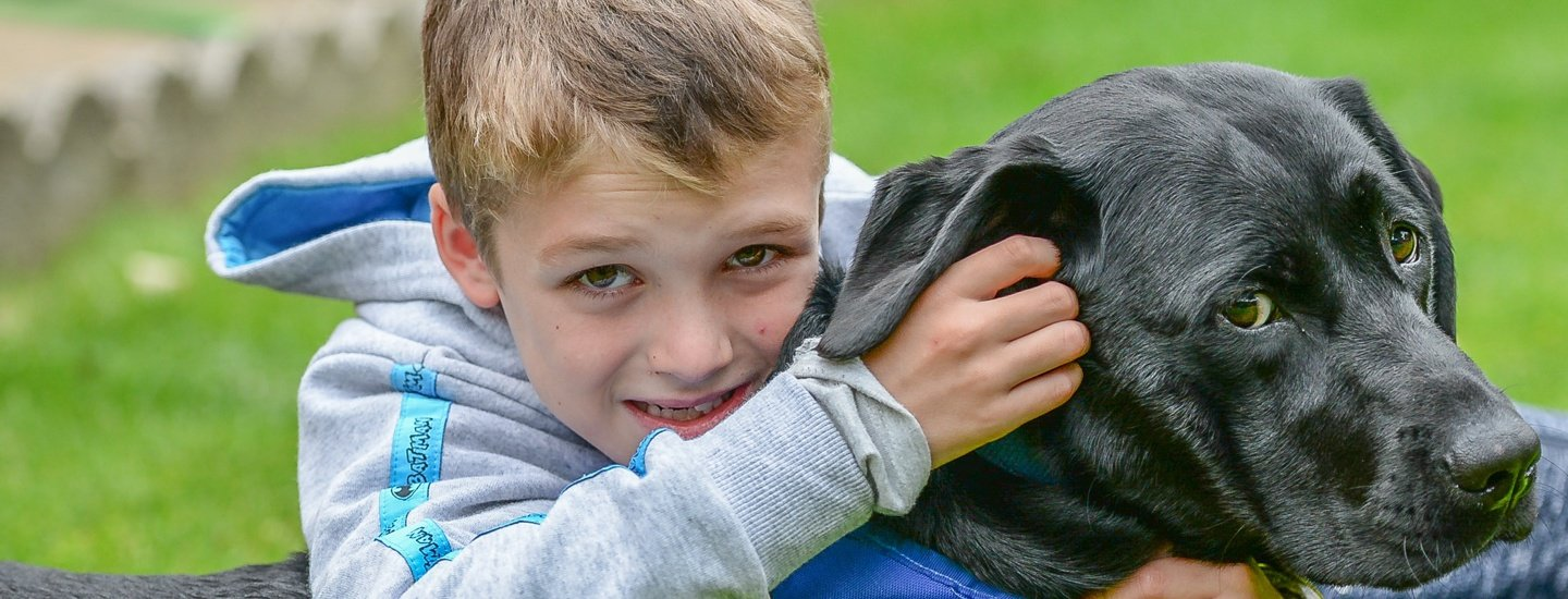 Sam Mills and Willow, autism assistance dog